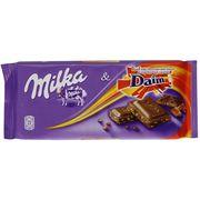 Молочный шоколад с кусочками карамели Milka & Daim 100 гр, фото 1