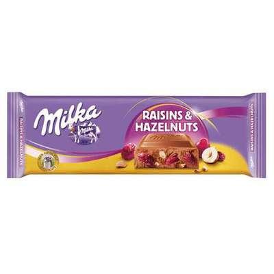 Большая шоколадка с изюмом и фундуком Milka Raisins Hazelnuts 270 гр, фото 1