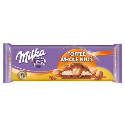 Большая плитка с цельным фундуком в ирисе и карамели Milka Toffee Whole Nuts 300 гр, фото 1